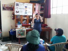 Sara (MMI's dentist) sharing oral hygiene techniques and the Gospel.